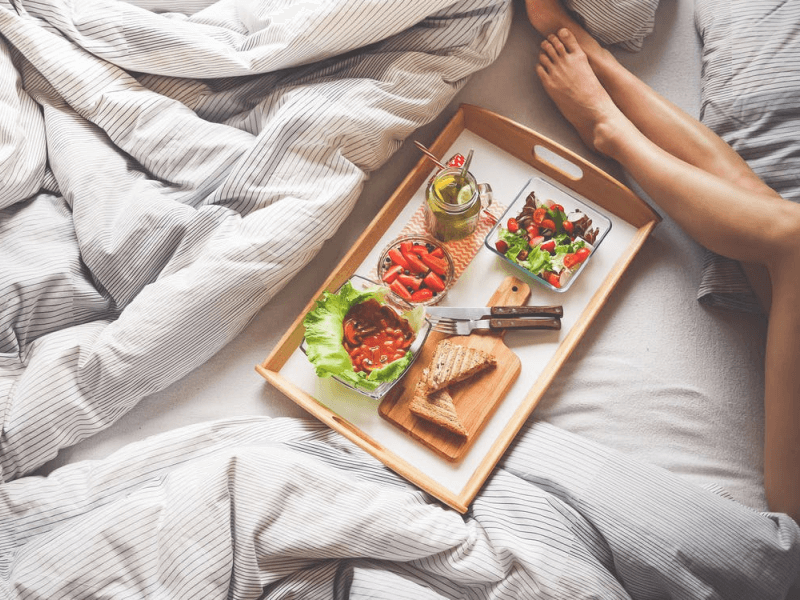 An assortment of food on a bed