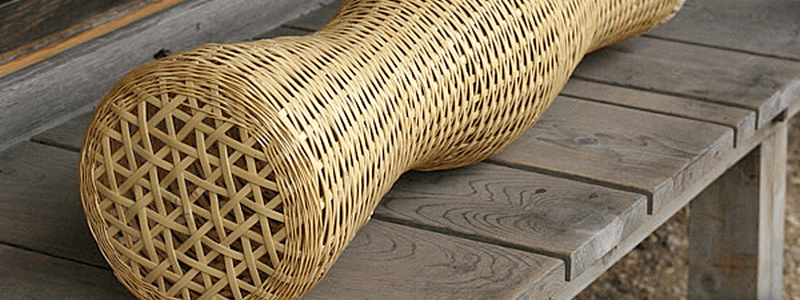 A curvy bamboo wife on a wooden table