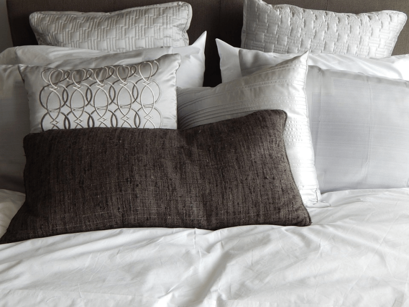 Assorted pillows on a bed