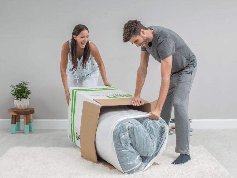 man and woman unboxing GhostBed mattress