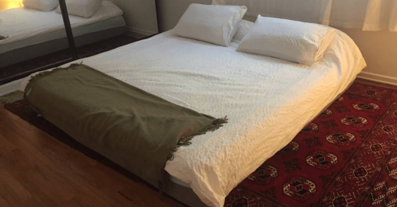 Nectar mattress with two pillows laid on carpeted floor