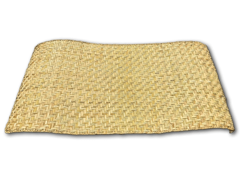 Unrolled petate handwoven mat on white background