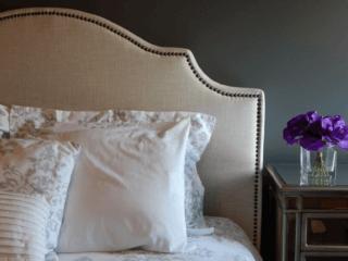 bed-pillows-nightstand-flowers-bedroom-design