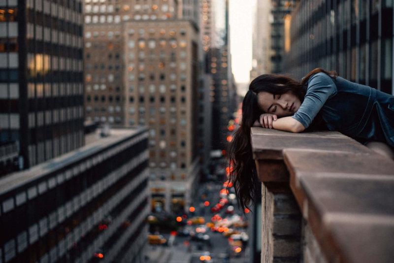 Woman asleep on a balcony