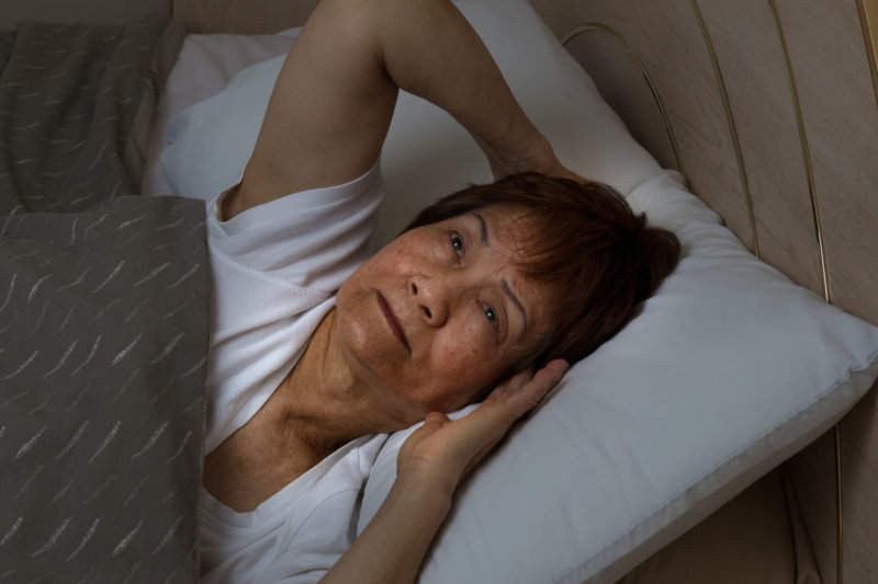 old woman awake in bed