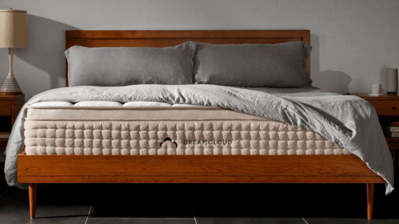 Dreamcloud mattress on varnished wooden frame