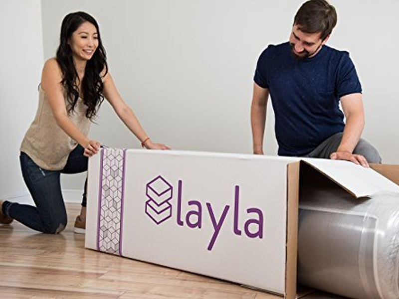 Layla Mattress being unboxed by man and woman