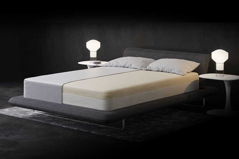 Eight Saturn+ smart mattress against gray background with half of mattress showing inner layers