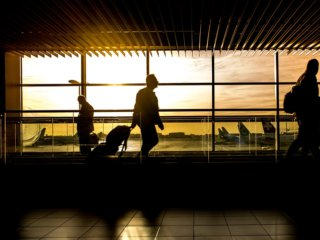 morning silhouette of man walking through airport