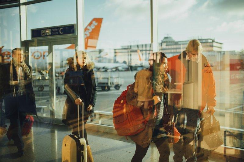 people walking inside an airport