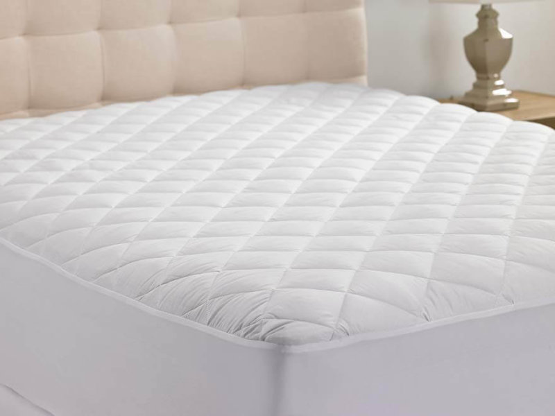 White Hanna Kay Extra-Deep Quilted Mattress Pad on mattress