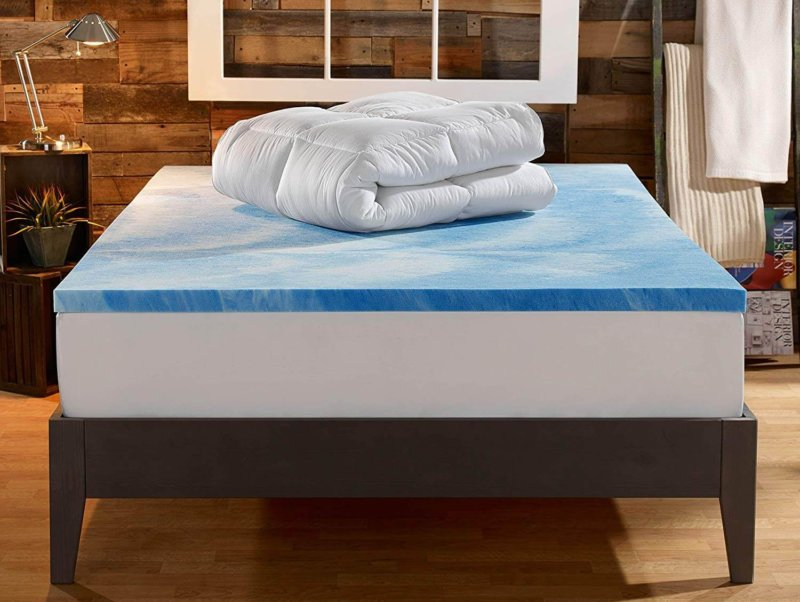 Sleep Innovations Dual Layer Mattress Topper deconstructed on mattress in messy bedroom