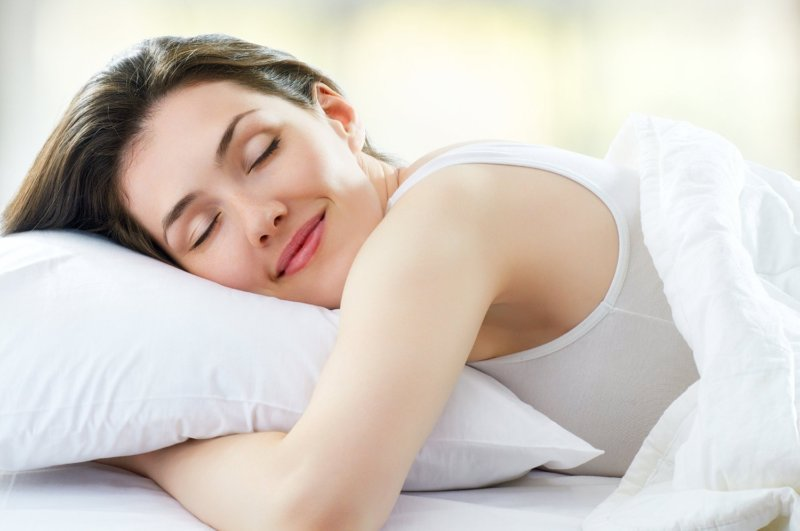 Woman in white sleeping on a pillow