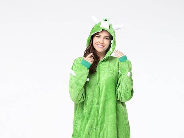 woman wearing green costume onesie